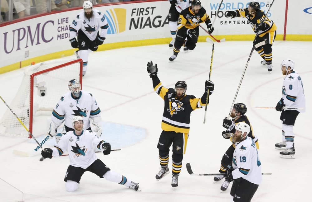 May 30, 2016; Pittsburgh, PA, USA; Pittsburgh Penguins center Nick Bonino (13) celebrates after scoring the game-winning goal against the San Jose Sharks in the third period game one of the 2016 Stanley Cup Final at Consol Energy Center. Mandatory Credit: Charles LeClaire-USA TODAY Sports