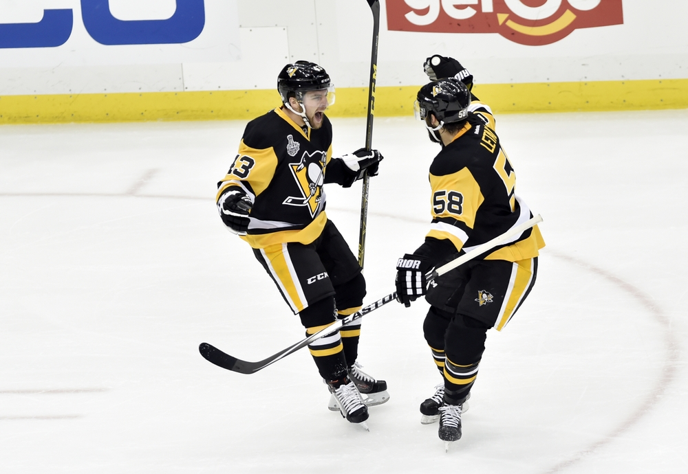 May 30, 2016; Pittsburgh, PA, USA; Pittsburgh Penguins left wing Conor Sheary (43) celebrates with defenseman Kris Letang (58) after scoring a goal against the San Jose Sharks in the first period in game one of the 2016 Stanley Cup Final at Consol Energy Center. Mandatory Credit: Don Wright-USA TODAY Sports