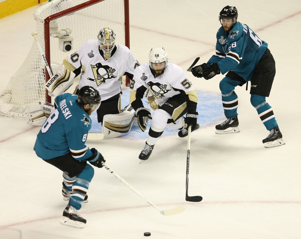 Jun 4, 2016; San Jose, CA, USA; San Jose Sharks center Joe Pavelski (8) looks to play the puck as Pittsburgh Penguins goalie Matt Murray (30), Pittsburgh Penguins defenseman Kris Letang (58) and San Jose Sharks right wing Melker Karlsson (68) look on in the second period of game three of the 2016 Stanley Cup Final at SAP Center at San Jose. Mandatory Credit: John Hefti-USA TODAY Sports
