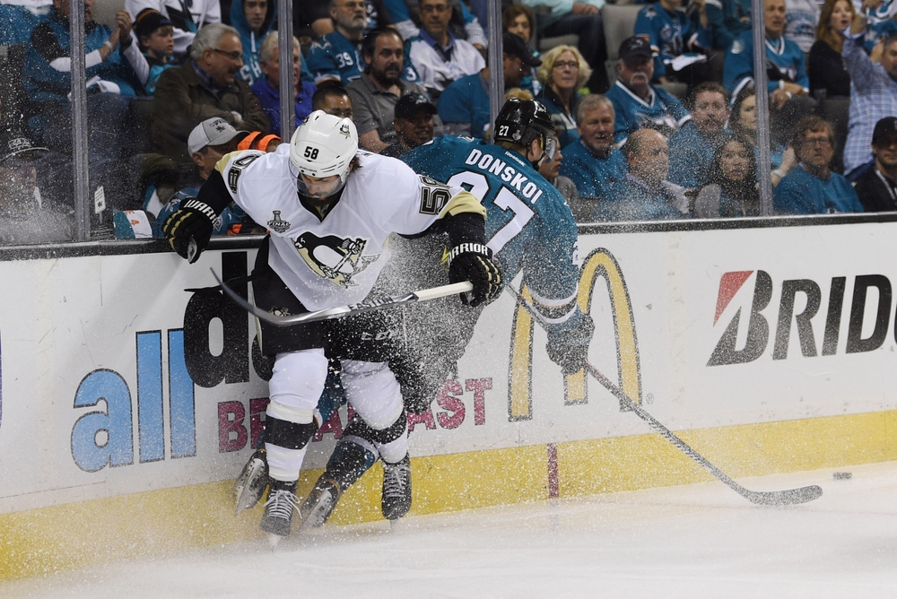 Jun 6, 2016; San Jose, CA, USA; Pittsburgh Penguins defenseman Kris Letang (58) collides with San Jose Sharks right wing Joonas Donskoi (27) in the first period in game four of the 2016 Stanley Cup Final at SAP Center at San Jose. Mandatory Credit: Kyle Terada-USA TODAY Sports