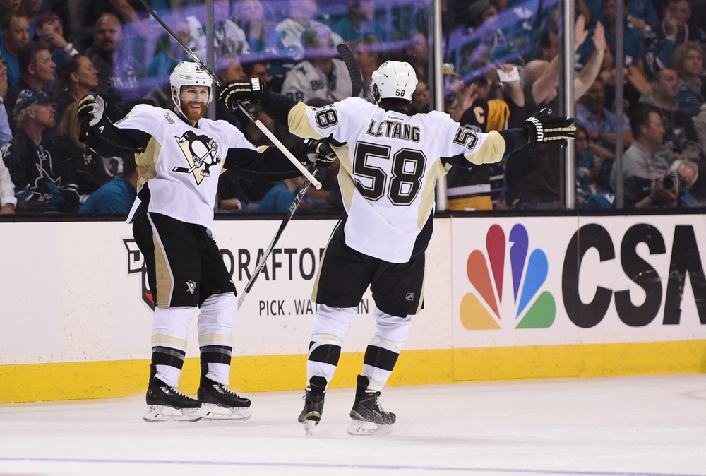 Jun 6, 2016; San Jose, CA, USA; Pittsburgh Penguins defenseman Ian Cole (28) celebrates with defenseman Kris Letang (58) after scoring a goal against the San Jose Sharks in the first period in game four of the 2016 Stanley Cup Final at SAP Center at San Jose. Mandatory Credit: Kyle Terada-USA TODAY Sports