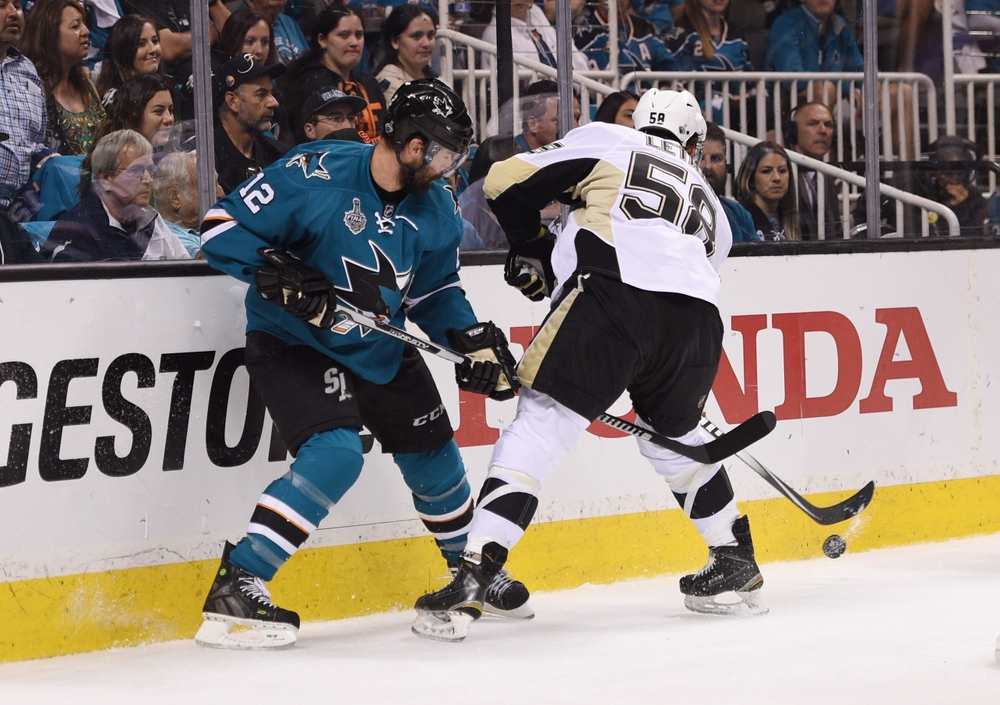 Jun 6, 2016; San Jose, CA, USA; San Jose Sharks center Patrick Marleau (12) battles for the puck with Pittsburgh Penguins defenseman Kris Letang (58) in the first period in game four of the 2016 Stanley Cup Final at SAP Center at San Jose. Mandatory Credit: Kyle Terada-USA TODAY Sports