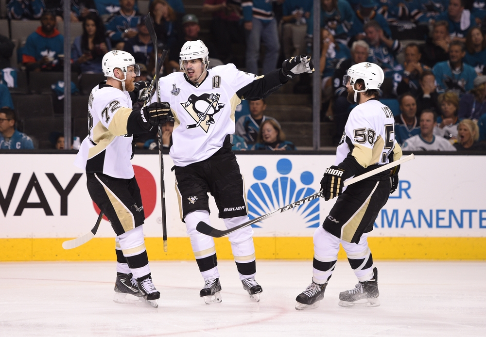 Jun 6, 2016; San Jose, CA, USA; Pittsburgh Penguins center Evgeni Malkin (71) celebrates with right wing Patric Hornqvist (72) and defenseman Kris Letang (58) after scoring a goal against the San Jose Sharks in the second period in game four of the 2016 Stanley Cup Final at SAP Center at San Jose. Mandatory Credit: Kyle Terada-USA TODAY Sports