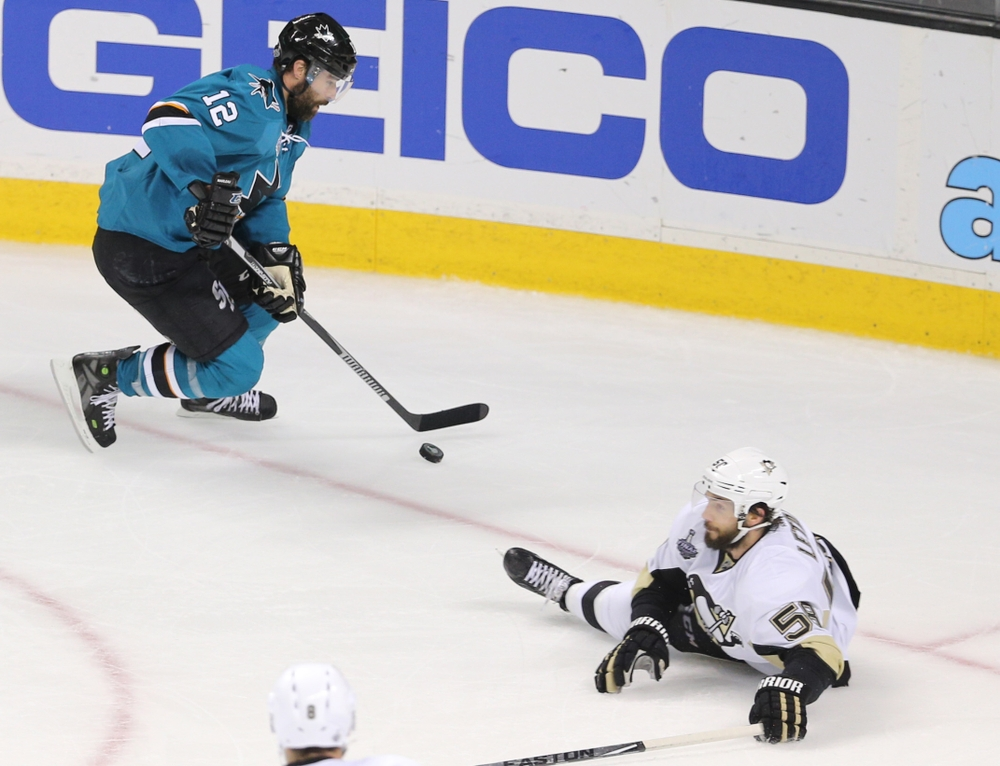 Jun 6, 2016; San Jose, CA, USA; San Jose Sharks center Patrick Marleau (12) moves around Pittsburgh Penguins defenseman Kris Letang (58) as he drops to the ice in the third period in game four of the 2016 Stanley Cup Final at SAP Center at San Jose. Mandatory Credit: John Hefti-USA TODAY Sports