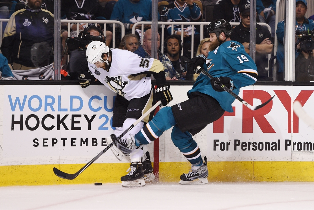 Jun 6, 2016; San Jose, CA, USA; Pittsburgh Penguins defenseman Kris Letang (58) battles for the puck with San Jose Sharks center Joe Thornton (19) in the third period in game four of the 2016 Stanley Cup Final at SAP Center at San Jose. Mandatory Credit: Kyle Terada-USA TODAY Sports