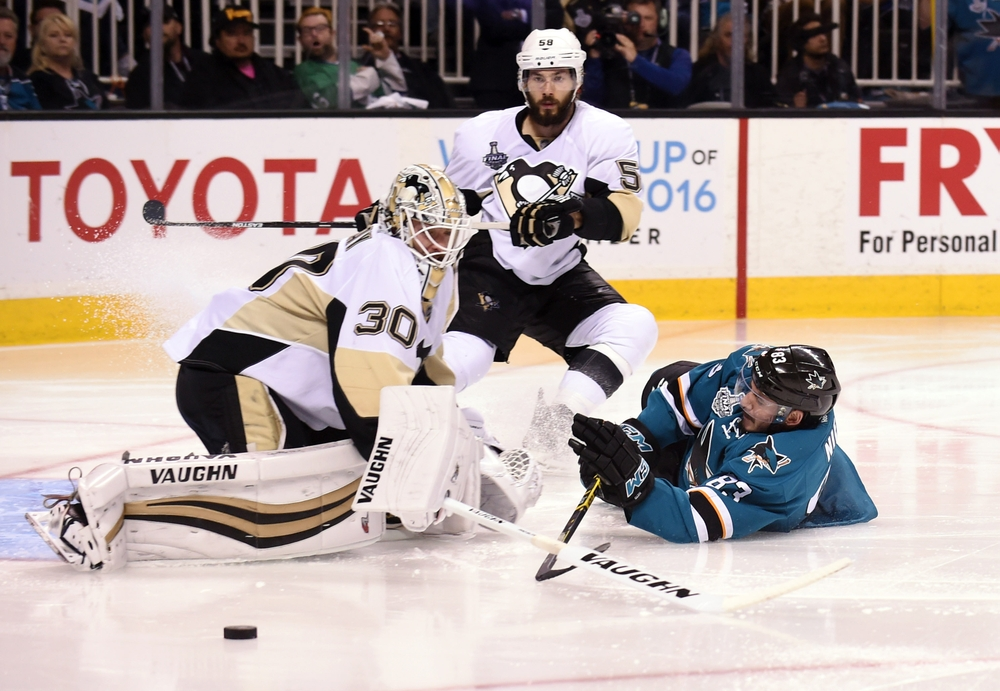 Jun 12, 2016; San Jose, CA, USA; San Jose Sharks left wing Matt Nieto (83) slides into Pittsburgh Penguins goalie Matt Murray (30) in the third period in game six of the 2016 Stanley Cup Final at SAP Center at San Jose. Mandatory Credit: Gary A. Vasquez-USA TODAY Sports