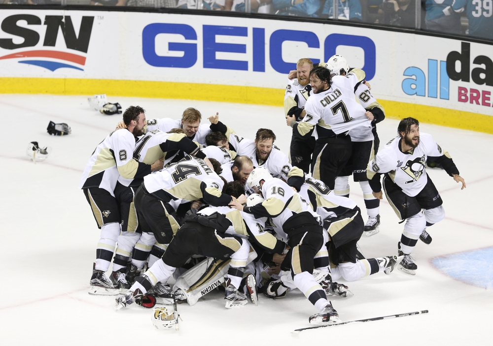 Jun 12, 2016; San Jose, CA, USA; Pittsburgh Penguins players celebrate on the ice after defeating the San Jose Sharks in game six of the 2016 Stanley Cup Final at SAP Center at San Jose. Mandatory Credit: John Hefti-USA TODAY Sports