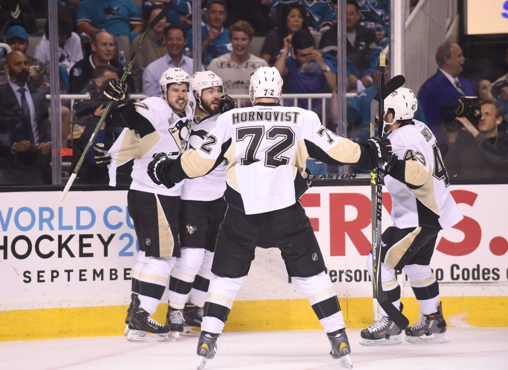 Jun 12, 2016; San Jose, CA, USA; Pittsburgh Penguins defenseman Kris Letang (58) celebrates with teammates Sidney Crosby (87) , Patric Hornqvist (72) and Conor Sheary (43) after scoring a goal against the San Jose Sharks in the second period in game six of the 2016 Stanley Cup Final at SAP Center at San Jose. Mandatory Credit: Gary A. Vasquez-USA TODAY Sports