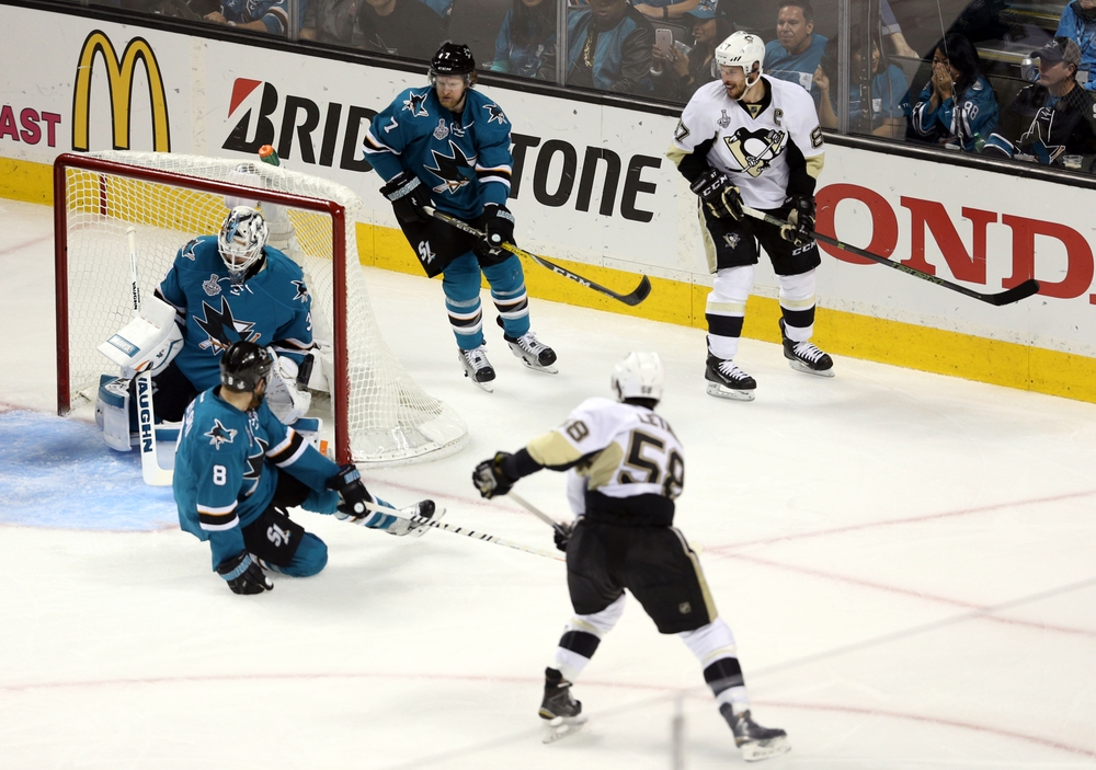 Jun 12, 2016; San Jose, CA, USA; Pittsburgh Penguins defenseman Kris Letang (58) scores a goal past San Jose Sharks goalie Martin Jones (31) in the second period of game six of the 2016 Stanley Cup Final at SAP Center at San Jose. Mandatory Credit: John Hefti-USA TODAY Sports