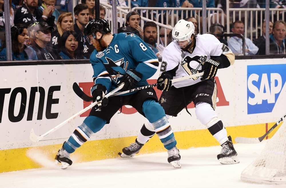 Jun 12, 2016; San Jose, CA, USA; San Jose Sharks center Joe Pavelski (8) battles for the puck with Pittsburgh Penguins defenseman Kris Letang (58) in the first period in game six of the 2016 Stanley Cup Final at SAP Center at San Jose. Mandatory Credit: Gary A. Vasquez-USA TODAY Sports
