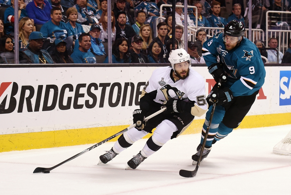 Jun 12, 2016; San Jose, CA, USA; Pittsburgh Penguins defenseman Kris Letang (58) controls the puck against San Jose Sharks right wing Dainius Zubrus (9) in the first period in game six of the 2016 Stanley Cup Final at SAP Center at San Jose. Mandatory Credit: Gary A. Vasquez-USA TODAY Sports