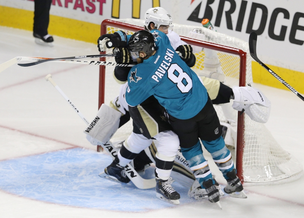 Jun 12, 2016; San Jose, CA, USA; San Jose Sharks center Joe Pavelski (8) collides with Pittsburgh Penguins defenseman Kris Letang (58) in the first period of game six of the 2016 Stanley Cup Final at SAP Center at San Jose. Mandatory Credit: John Hefti-USA TODAY Sports