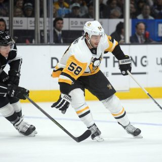November 3, 2016; Los Angeles, CA, USA; Pittsburgh Penguins defenseman Kris Letang (58) moves the puck against the defense of Los Angeles Kings center Tyler Toffoli (73) during the first period at Staples Center. Mandatory Credit: Gary A. Vasquez-USA TODAY Sports