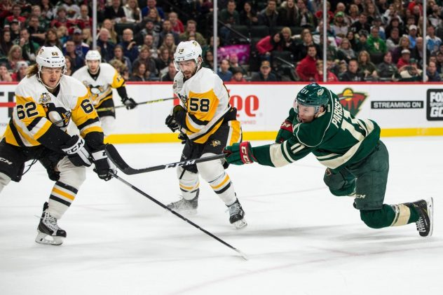 Nov 25, 2016; Saint Paul, MN, USA; Minnesota Wild forward Zach Parise (11) shoots and scores a goal in front of Pittsburgh Penguins defenseman Kris Letang (58) and forward Carl Hagelin (62) during the second period at Xcel Energy Center. Mandatory Credit: Brace Hemmelgarn-USA TODAY Sports