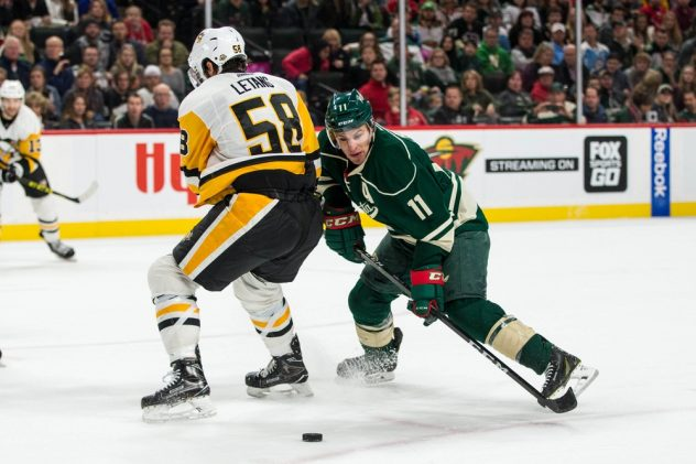 Nov 25, 2016; Saint Paul, MN, USA; Minnesota Wild forward Zach Parise (11) shoots and scores a goal in front of Pittsburgh Penguins defenseman Kris Letang (58) during the second period at Xcel Energy Center. Mandatory Credit: Brace Hemmelgarn-USA TODAY Sports