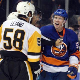 Nov 30, 2016; Brooklyn, NY, USA; Pittsburgh Penguins defenseman Kris Letang (58) and New York Islanders center Casey Cizikas (53) argue during the third period at Barclays Center. Mandatory Credit: Brad Penner-USA TODAY Sports