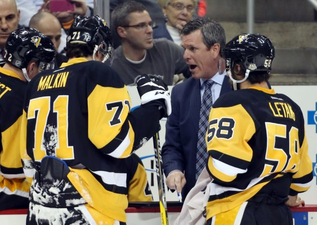 Dec 1, 2016; Pittsburgh, PA, USA; Pittsburgh Penguins head coach Mike Sullivan (second from right) talks with the Penguins during a time-out against the Dallas Stars during the second period at the PPG PAINTS Arena. The Penguins won 6-2. Mandatory Credit: Charles LeClaire-USA TODAY Sports