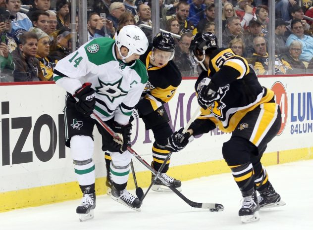 Dec 1, 2016; Pittsburgh, PA, USA; Dallas Stars left wing Jamie Benn (14) battles for the puck with Pittsburgh Penguins defenseman Olli Maatta (3) and defenseman Kris Letang (58) during the first period at the PPG PAINTS Arena. Mandatory Credit: Charles LeClaire-USA TODAY Sports