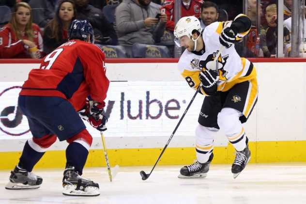 Jan 11, 2017; Washington, DC, USA; Pittsburgh Penguins defenseman Kris Letang (58) skates with the puck as Washington Capitals defenseman Dmitry Orlov (9) defends in the second period at Verizon Center. The Capitals won 5-2. Mandatory Credit: Geoff Burke-USA TODAY Sports