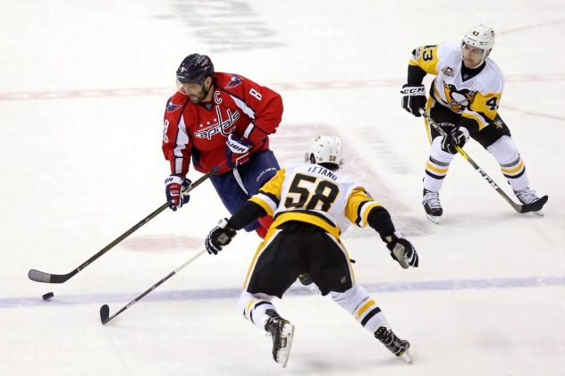 Jan 11, 2017; Washington, DC, USA; Washington Capitals left wing Alex Ovechkin (8) skates with the puck as Pittsburgh Penguins defenseman Kris Letang (58) defends in the first period at Verizon Center. Mandatory Credit: Geoff Burke-USA TODAY Sports