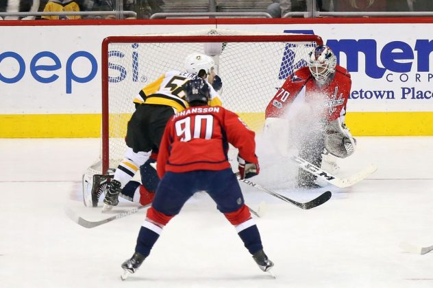 Jan 11, 2017; Washington, DC, USA; Washington Capitals goalie Braden Holtby (70) makes a save on Pittsburgh Penguins defenseman Kris Letang (58) in the first period at Verizon Center. Mandatory Credit: Geoff Burke-USA TODAY Sports