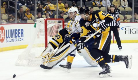 Jan 31, 2017; Pittsburgh, PA, USA; Nashville Predators center Calle Jarnkrok (19) and Pittsburgh Penguins defenseman Kris Letang (58) chase the puck after a save by Penguins goalie Matt Murray (30) during the third period at the PPG PAINTS Arena. The Penguins won 4-2. Mandatory Credit: Charles LeClaire-USA TODAY Sports