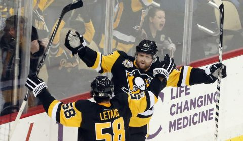 Feb 3, 2017; Pittsburgh, PA, USA;  Pittsburgh Penguins right wing Phil Kessel (81) and defenseman Kris Letang (58) celebrate after Kessel scored the game winning power play goal in overtime to defeat the Columbus Blue Jackets at the PPG PAINTS Arena. The Penguins won 4-3 in overtime. Mandatory Credit: Charles LeClaire-USA TODAY Sports