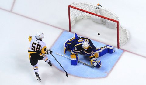 Feb 4, 2017; St. Louis, MO, USA; Pittsburgh Penguins defenseman Kris Letang (58) scores on a breakaway against St. Louis Blues goalie Jake Allen (34) during the second period at Scottrade Center. The Penguins won 4-1. Mandatory Credit: Jeff Curry-USA TODAY Sports