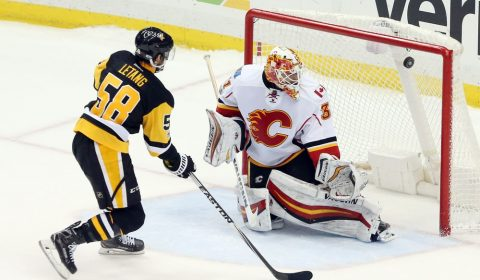 Feb 7, 2017; Pittsburgh, PA, USA; Calgary Flames goalie Chad Johnson (31) makes a save against Pittsburgh Penguins defenseman Kris Letang (58) to secure a shootout win at the PPG PAINTS Arena. Calgary won 3-2 in a shootout. Mandatory Credit: Charles LeClaire-USA TODAY Sports