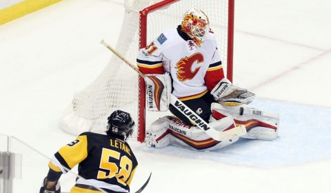 Feb 7, 2017; Pittsburgh, PA, USA; Calgary Flames goalie Chad Johnson (31) makes a save against Pittsburgh Penguins defenseman Kris Letang (58) during the second period at the PPG PAINTS Arena. Mandatory Credit: Charles LeClaire-USA TODAY Sports